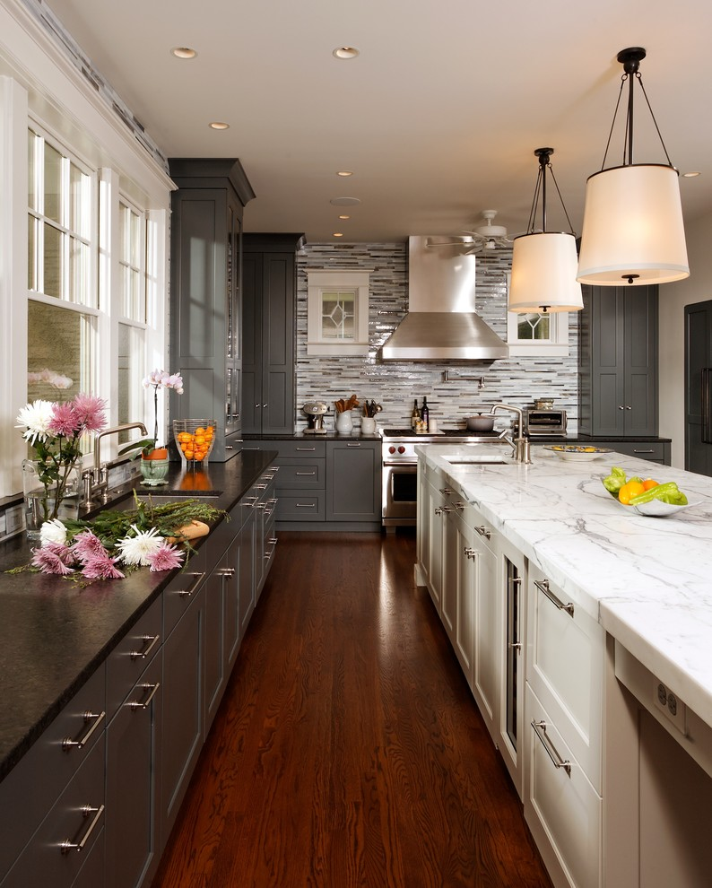 Transitional kitchen photo in Chicago with an undermount sink, shaker cabinets, gray cabinets, gray backsplash, matchstick tile backsplash and stainless steel appliances