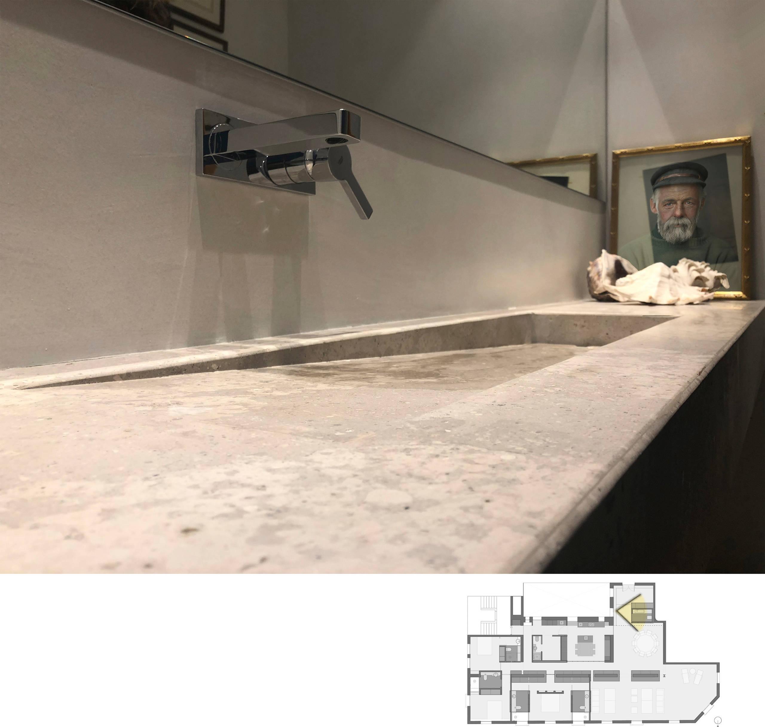 Detalle del lavabo del aseo de cortesía.
