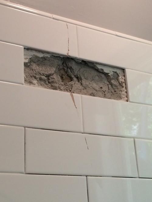 Cracked Subway Tiles In Remodeled Bathroom