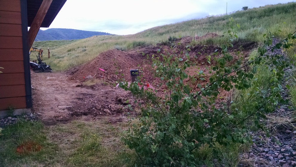 notice the slope come almost to the home in back