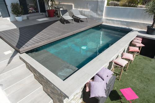 la piscine se transforme en terrasse. Black Bedroom Furniture Sets. Home Design Ideas