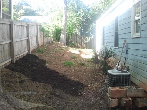 Side yard slopes towards house