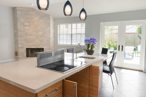 The remodeled kitchen island now has an attached, 31-inch-high table ...