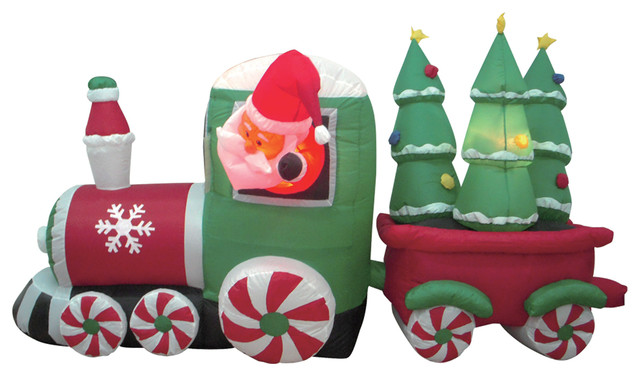 wide inflatable santa claus driving train on candy wheels with christmas trees