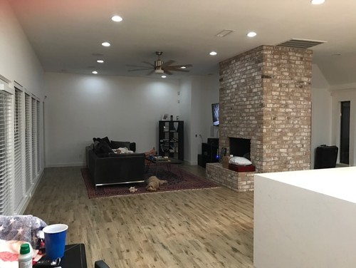 Not sure what to do with the big blank wall or what other pieces (coffee  table, accent chairs/tables, lighting, etc) could help tie it all together.