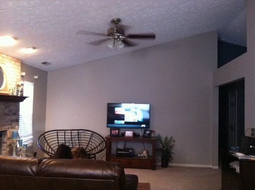 How to decorate large wall with TV ?
