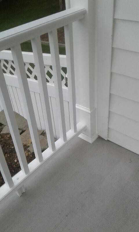 finished concrete patio and railing