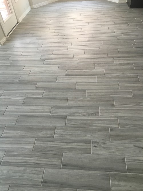 We're having tile issues on the walls in the bathroom and kitchen so now  I'm questioning everything the tiles guys did. Thanks in advance! - Porcelain Wood Look Tile Pattern?