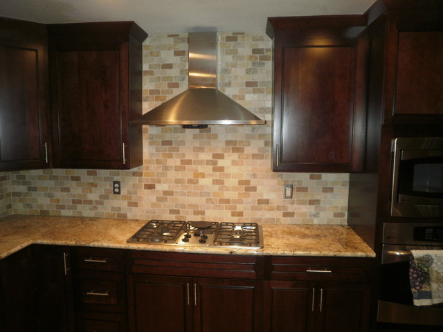 traditional kitchen solarius slab and tumbled travertine