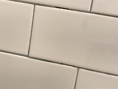 Bad Tile Job Grout Dark In Certain Areaschipped Tile Cuts