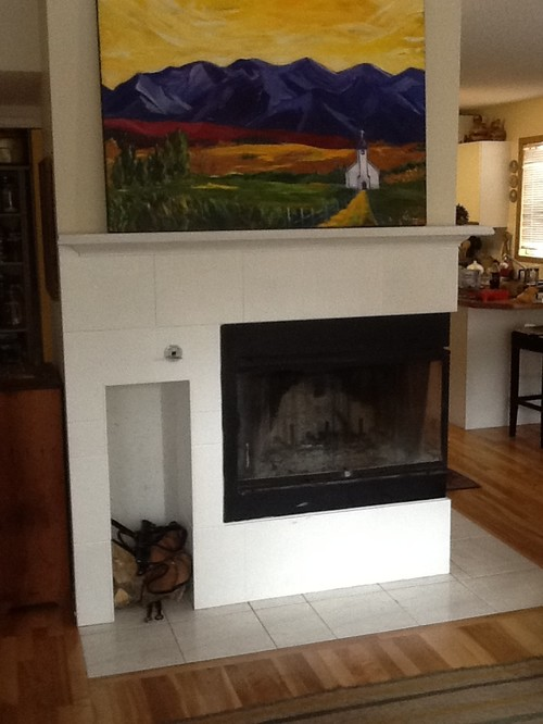 Need some ideas to refresh our fireplace.  I painted the old oak mantle and 80
