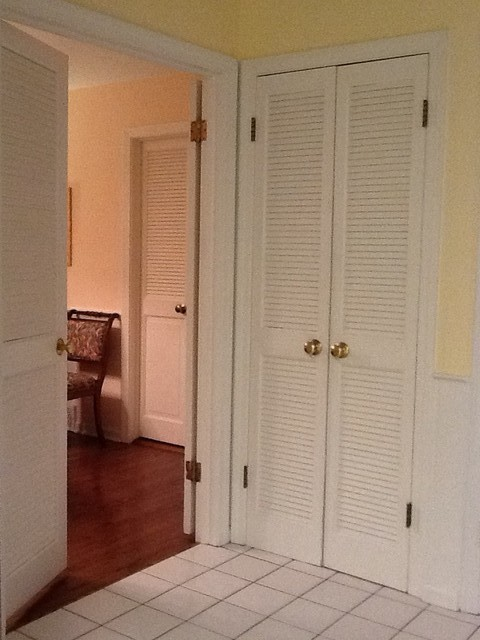 linen doors hallway linen cupboard in a cullen bay. Black Bedroom Furniture Sets. Home Design Ideas