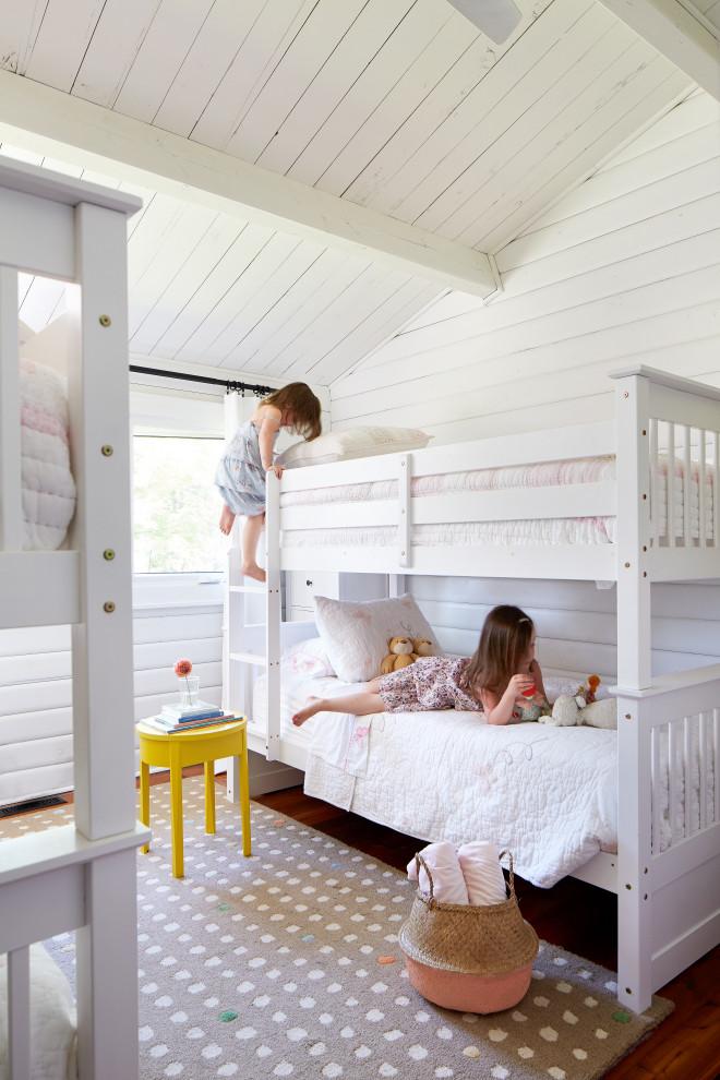 Kids' room - mid-sized cottage medium tone wood floor kids' room idea in Toronto with white walls