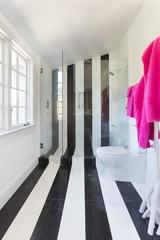 vertical-black-and-white-stripe-shower-tile-attic-shower-sloped-ceiling.jpg (493