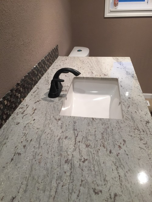 Captivating Granite Countertops Installed With Too Much Overhang