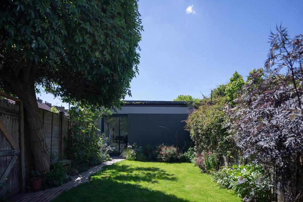 Single storey side extension with Outbuilding - Sidcup