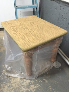 Staining project help - wood on edge of table different than top?
