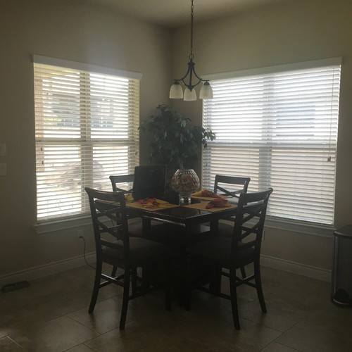 Chandelier And Curtains In The Breakfast Area