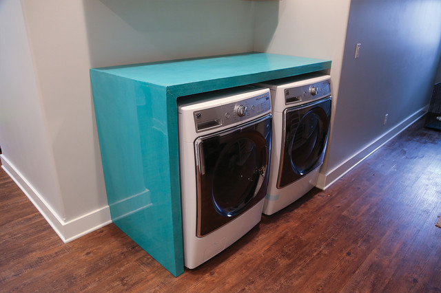 Custom teal laundry room counter over washer and dryer for Laundry room countertop over washer and dryer