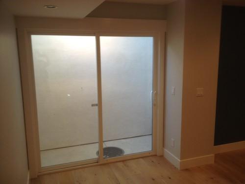 Ideas to dress up a boring basement light well?