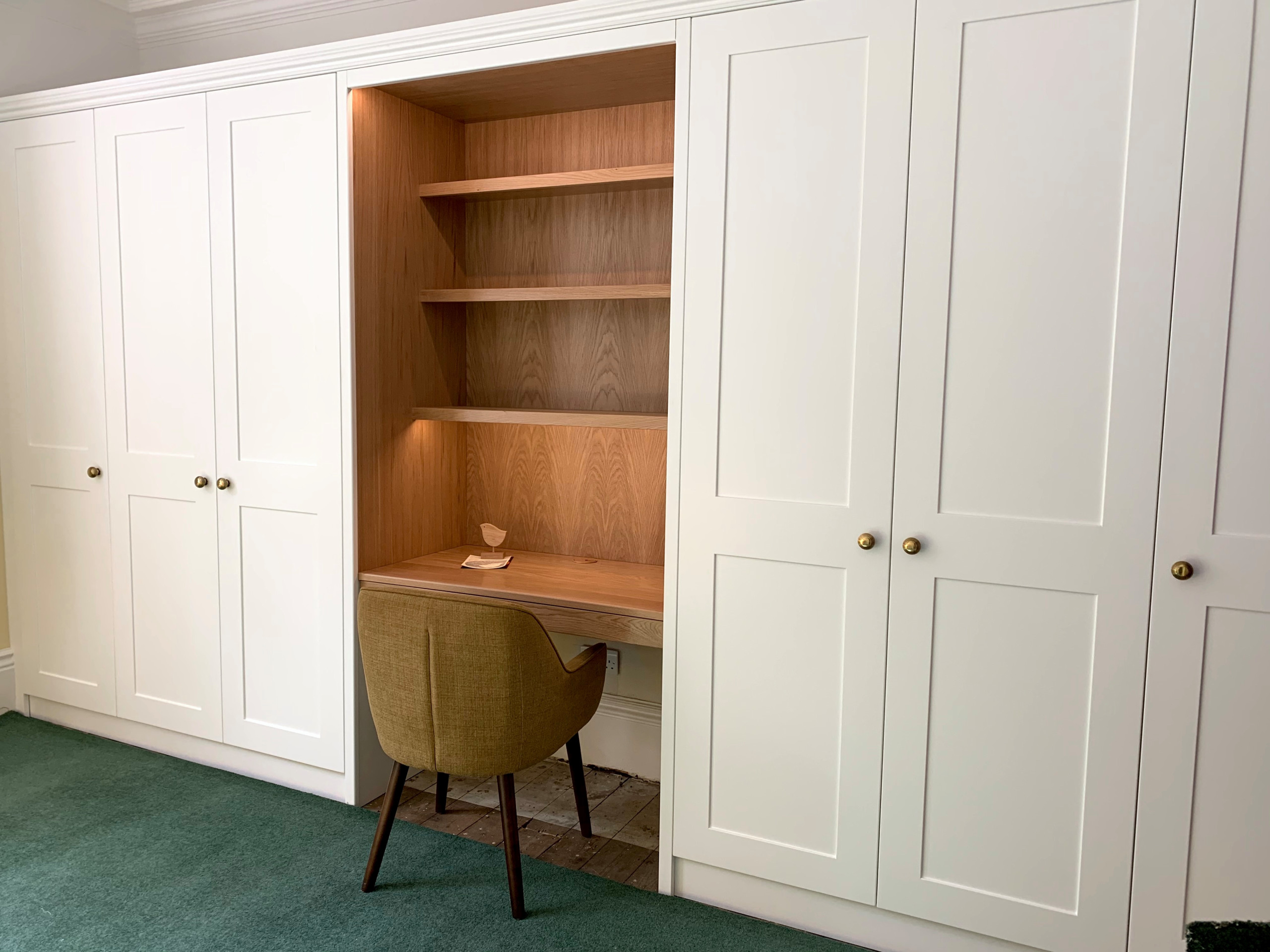 Wardrobes with white spray painted shaker doors and oak desk area
