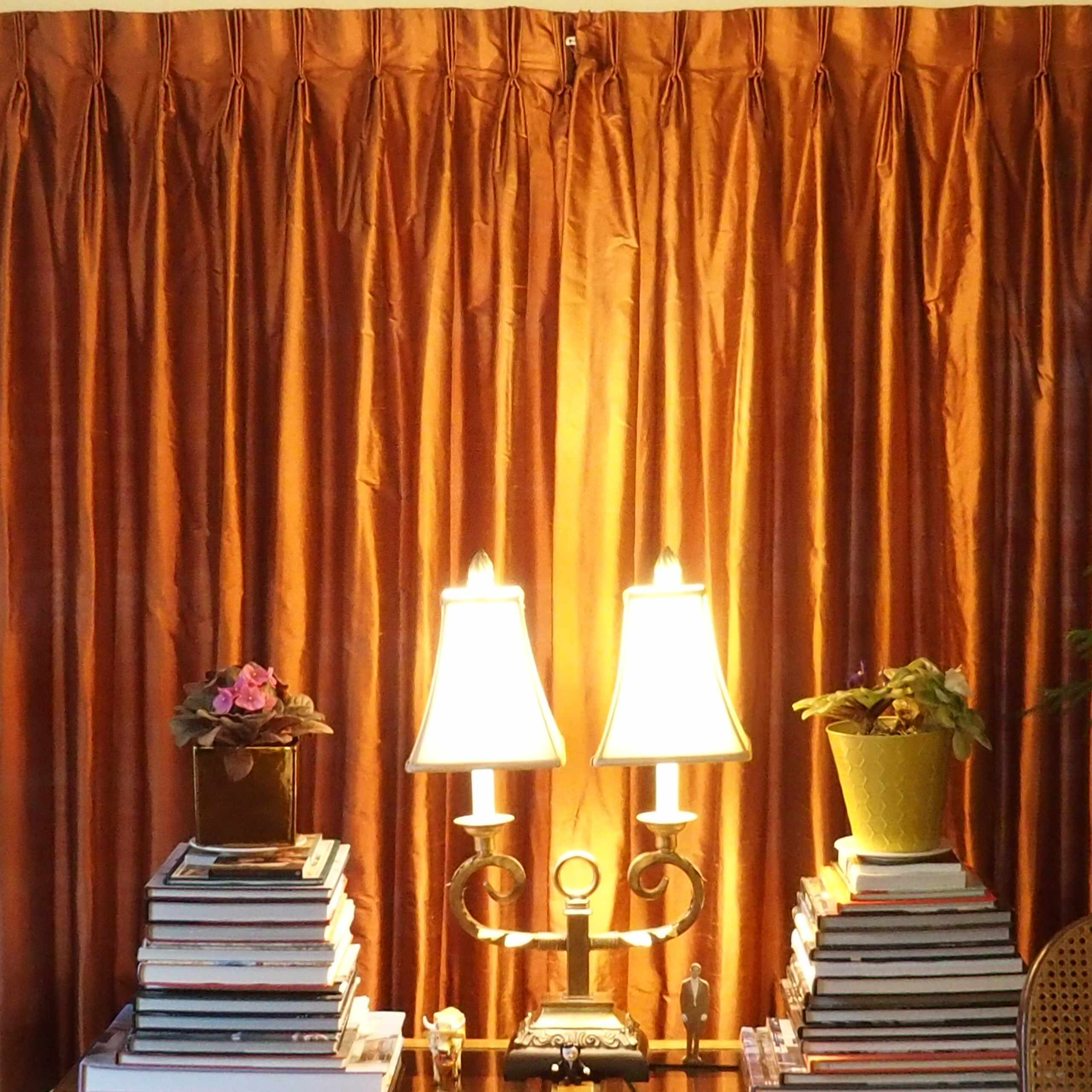 Living room with russet silk draperies, interlined and lined with thermal lining