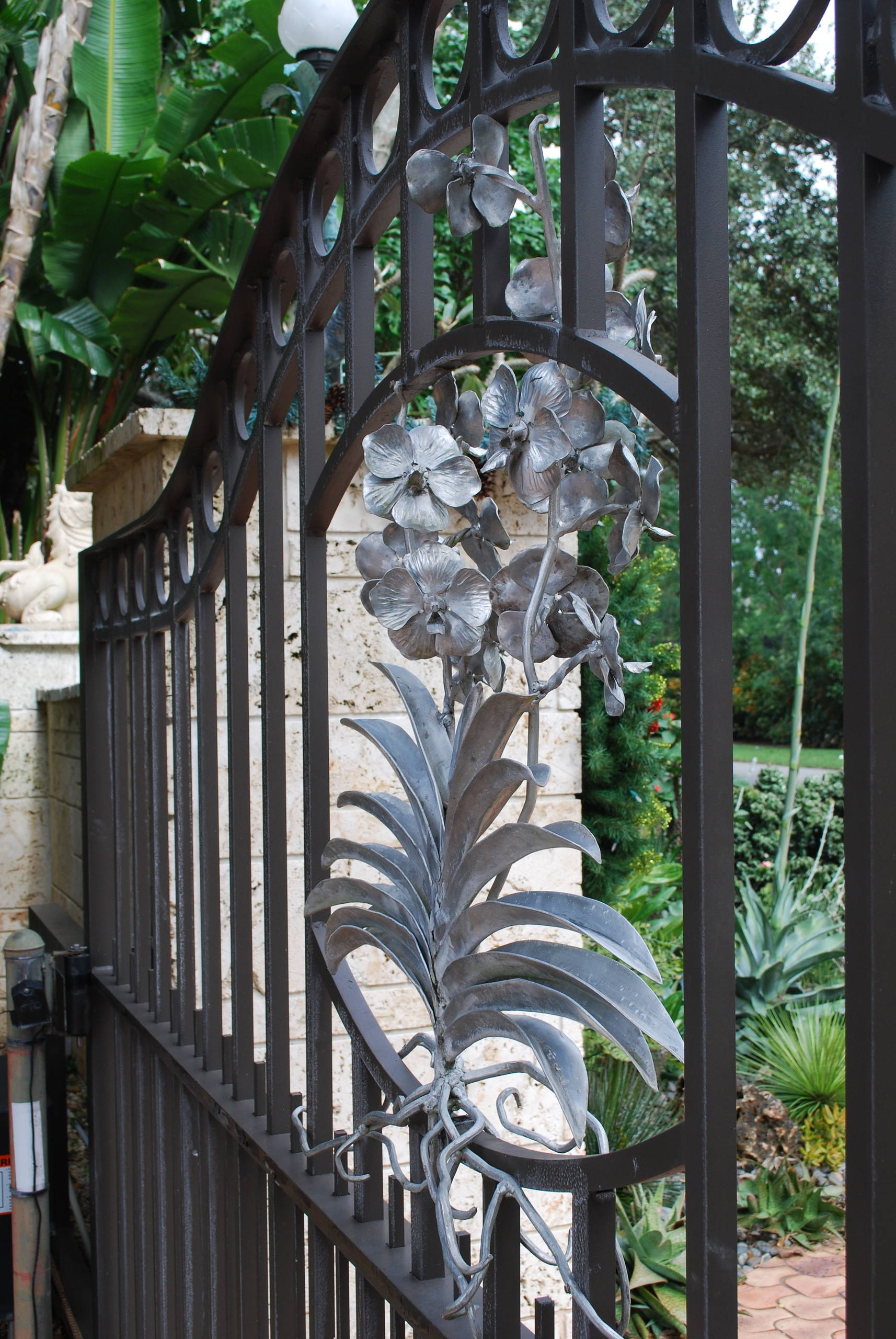 A vanda sculpture adorns the front gate