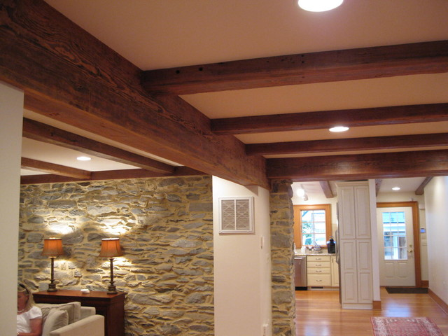 Reclaimed Heart Pine Beam Wraps Traditional Basement