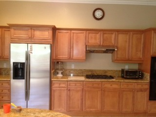 Should I get these maple kitchen cabinets painted mocha white?