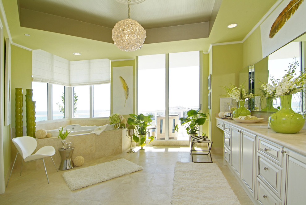 Inspiration for a mid-sized contemporary master beige tile and stone tile travertine floor and beige floor doorless shower remodel in Miami with marble countertops, green walls, an undermount sink, raised-panel cabinets, beige cabinets, a hot tub, a one-piece toilet and beige countertops