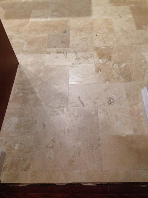 2 Ugly travertine pattern tiles placed in open area. Not happy :(