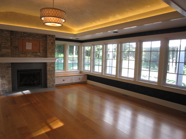 Sunroom With Stone Fireplace Tray Ceiling Led Lighting