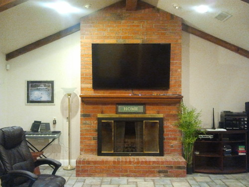 Reface a floor-to-ceiling brick fireplace