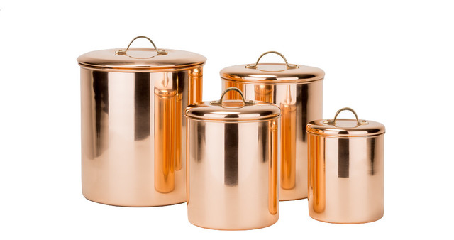 4 Piece Polished Copper Canister Set With Brass Knobs.