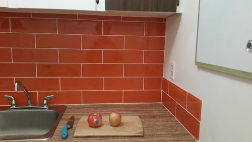 Kitchen Backsplash Orange cabinet colours to go with orange glass tile backsplash?