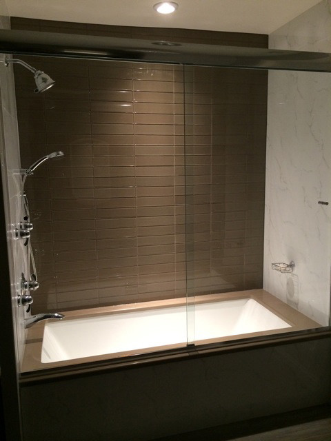 Soaker Tub With Custom Frameless Glass Sliding Doors