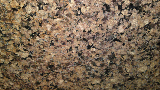 Desert Brown Granite great contrast with White Cabinets traditional