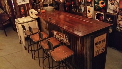 Rustic Bar Made Out Of Antique Door For Top And Rusted Corrugated Tin Roof Wrapped Base