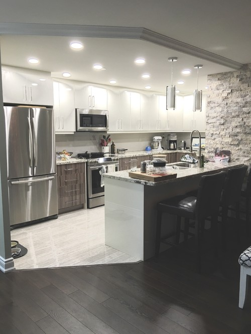 Adding plug outlet to island in kitchen electrician advice