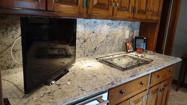 White eyes granite with full height granite backsplash