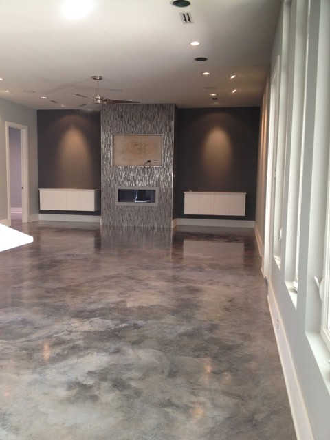Dyed concrete modern home theater new orleans by for Concrete floors in house