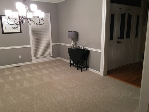 Replace carpet with wood flooring before furniture purchase