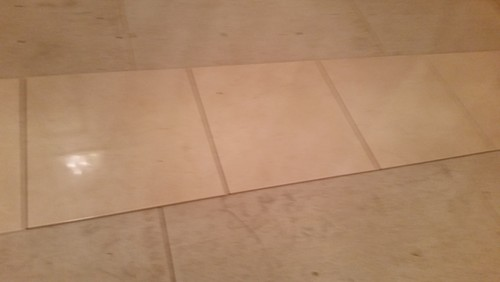 Can 18x18 Polished Porcelain Tile Installed Groutless On