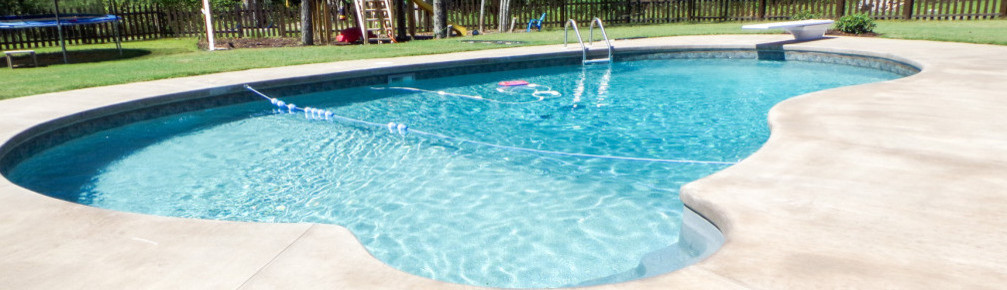 Pools By Design Reviews custom circle jacuzzi in the custom swimming pool corner with natural and scenic surrounding view Pools By Design 1 Reviews Projects Carthage Ms