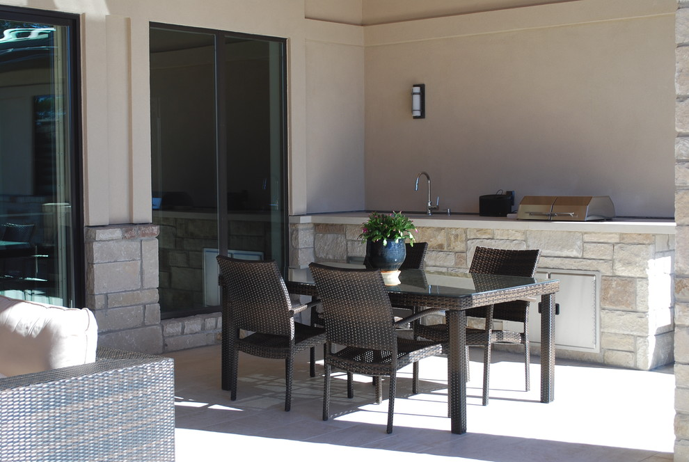 Covered patio with grill and sink