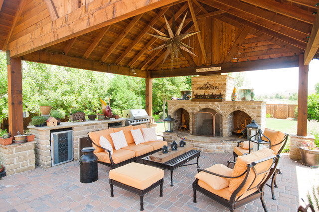Outdoor Entertainment Designs outdoor entertainment area with covering, fireplace, kitchen and