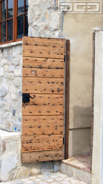 Antique european gate retrofit with architectural hardware for European exterior doors