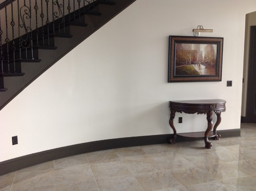 How To Decorate Curved Staircase Wall