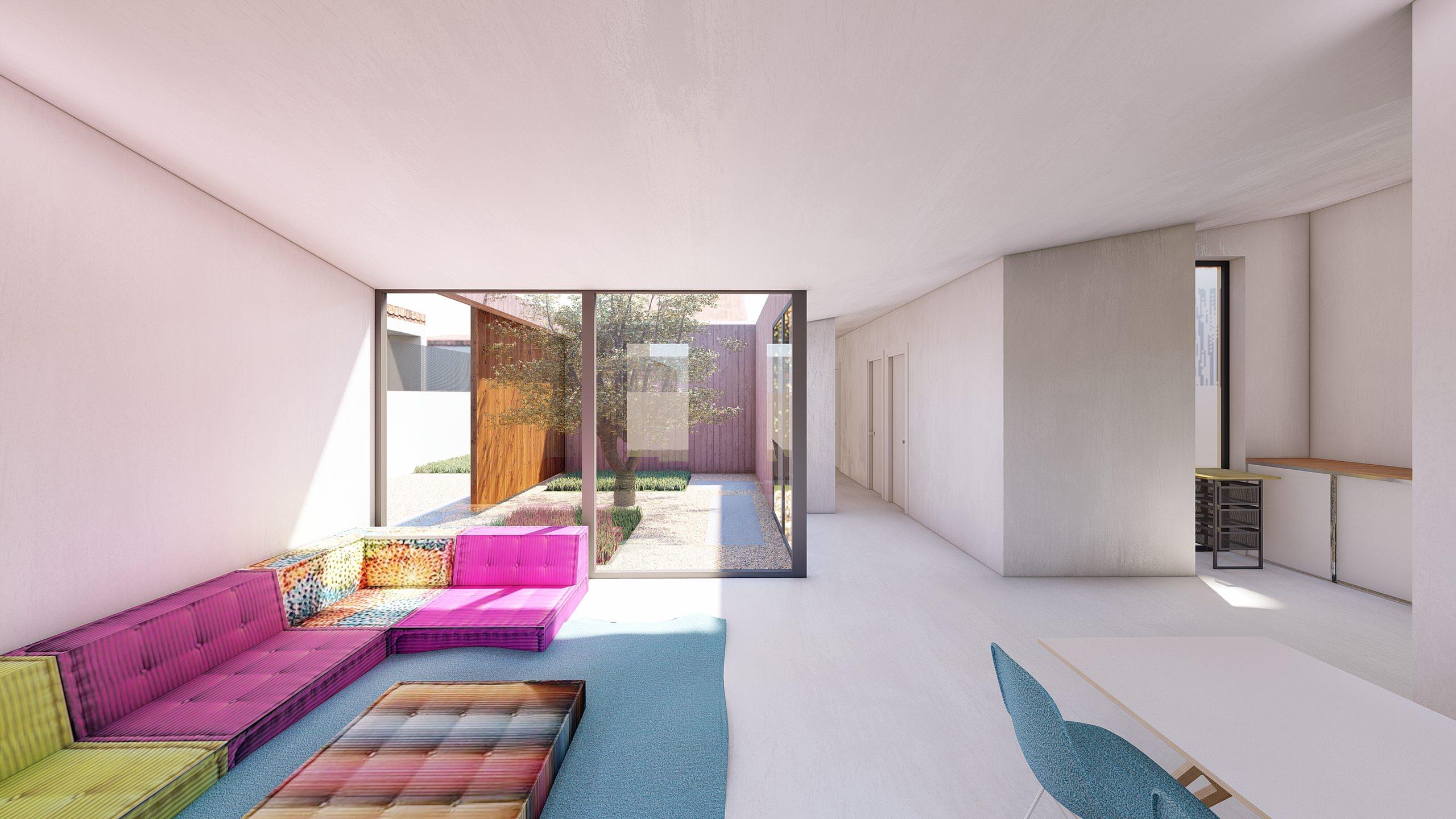 Vista del salón y conexión con el patio interior
