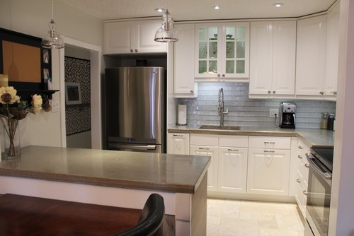 Renovated Kitchen With IKEA Cabinets, Glass Tile Backsplash, Concrete  Countertops And Marble Floors.